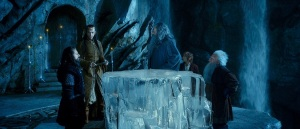 Bilbo attending a secret council in Rivendell, the home of the elves, along with Thorin (Richard Armitage), Elrond (Hugo Weaving), Gandalf (Ian McKellen) and another dwarf.