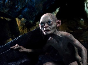 Gollum (Andy Serkis), enhanced thanks to modern technology, playing a game of riddles with Bilbo.