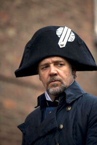 Inspector Javier (Russell Crowe), wearing almost the identical garb of the former (and now fallen) Emperor Napoleon Bonaparte I, on the lookout for Jean Valjean.