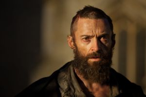 Jean Valjean (Hugh Jackman), looking like a scraggy vagabond, as a convicted criminal about to be released on parole.