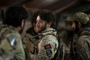 Patrick (Joel Edgerton) enjoying banter with his marine companions before leading them to into combat to kill Bin Laden.