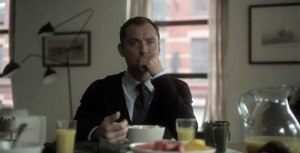 Dr. John Banks (Jude Law) chewing his breakfast, wondering how his world has turned upside down due to Emily's reaction to the drugs he prescribed her.