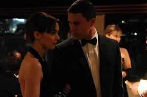 Martin (Channing Tatum) and Emily (Rooney Mara) looking like an aesthetically perfect couple, dressed smartly at a friend's party.