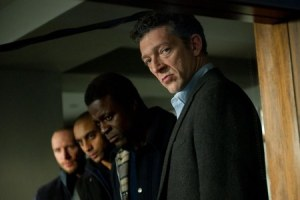 Franck (Vincent Cassel), furtherst right, keeping a worryingly close eye on Simon's treatement, with his group of thugs alongside him to illustrate the consequences for Simon if he fails to shake off his amnesia.