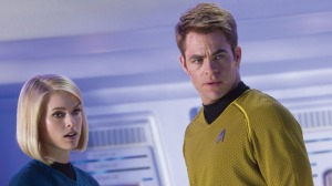 Captain James Kirk (Chris Pine) mulling over whether it would be a good idea to take Dr. Carol Marcus (Alice Eve) on board.