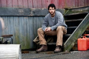 Clarke Kent (Henry Cavill) working as a blue-collar worker, unsure as to who he really is or where his life is taking him.