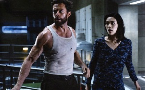 Logan/Wolverine (Hugh Jackman) running with Mariko (Tao Okamoto), trying to protect her from assassins working for... well that's anyone's guess.