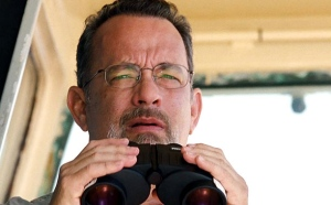 Captain Phillips (Tom Hanks) on the look out for pirates... and worried by how quickly they're advancing toward his ship.