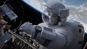 Dr. Ryan Stone (Sandra Bullock) making some repairs to the shuttle in view of Earth.