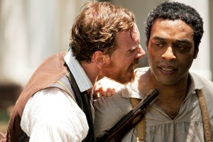 Epps (Michael Fassbender), the nastiest of all the slave owners, shouting crazily at an enslaved Solomon, tormenting him.