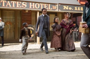 Solomon (Chiwetel Ejiofor), as a free man, with his family in New York.