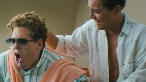 A drugged-up Belfort having some non-work related fun with his equally drugged-up friend and business partner, Donnie (Jonah Hill).