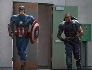 Steve Rogers/Captain America (Chris Evans), in full garb, ready to take out his (and America's) enemies, alongside the Falcon (Anthony Mackie).
