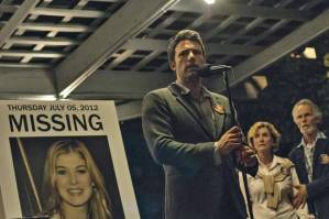 Nick appealing to the public to help him find Amy, with posters of her missing to raise awareness about the situation.