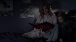 Amelia reading Sam a book to help him go to sleep. Only, without realising it, she is reading to him the poetry book written by the Babadook.
