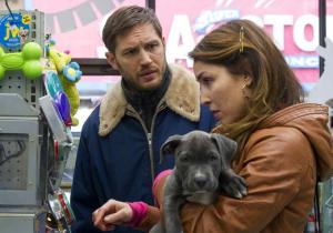 Bob with Nadia (Noomi Rapace), buying stuff for the pitbull puppy, Rocco.