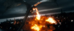 Smaug the Dragon (voiced thunderously by Benedict Cumberbatch) is our of the Lonely Mountain and torching Laketown.