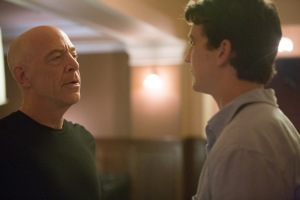 Andrew (Miles Teller) looking and listening to his mentor, the conductor Terence Fletcher (JK Simmons) as Fetcher gives him some advice.