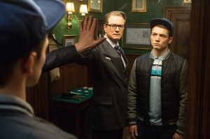 harry (Colin Firth) showing Eggsy (Taron Egerton) the secret way of entering the world of a Kingsman.