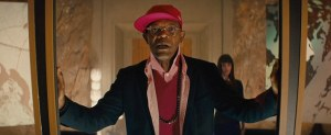 Valentine (Samuel L Jackson) looking laughably ridiculous as the utterly camp villain, wanting to start the world anew.