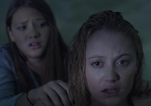 Kelly (Lili Sepe) attempting to calm Jay down upon the latter seeing a demon closing in on her.
