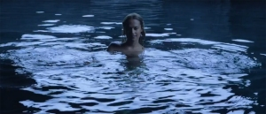 Alice (Alicia Vikander) rising seductively in the lake to entrance someone (I wonder who?) with her beauty.