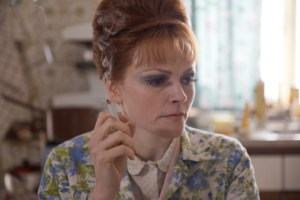 Eileen (Maxine Peake) smoking. She is Lydia's hair-dresser mother who suffers from Agorophobia.