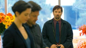 Gordo (Joel Edgerton) staring with unsettling intent at Simon and Robyn at the store.