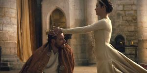 Lady Macbeth (Marion Cotillard) trying to soothe her now kingly husband at Bamburgh Castle.