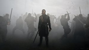 Macbeth (Michael Fassbender), bloody and filthy, in the heart of a battle.