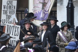 Maud at a demonstration for women's right to vote with Violet Miller (Anne-Marie Duff, left) and Edith Ellyn (Helena Bonham Carter, right).