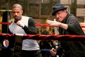 Rocky (Sylvester Stallone, right), giving his pupil, Adonis Creed (Michael B. Jordan, left), some advice on how to defeat a foe in the ring.