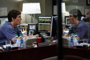 Dr Michael Burry (Christian Bale), in his office, listening to music whilst working out that the US property market would collapse in 2007.