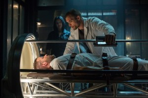 Wade about to undergo an experimental procedure, with Ajax (Ed Skrein) looking over him and telling him so much that he would not want to hear.