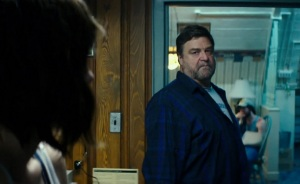Howard (John Goodman) staring at Michelle, warning her not to go into his room or to push her luck.