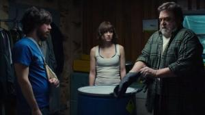 Howard believes that there is a traitor among them, so brings out some highly corrosive substance to tacitly threaten Michelle and another captive, Emmett (John Gallagher Jr).