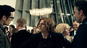The villainous Lex Luthor (Jesse Eisenberg), getting in away of a first and tense encounter between Clarke Kent (Henry Cavill) and Bruce Wayne (Ben Affleck).