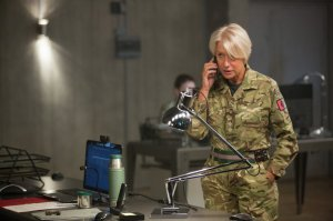 Colonel Katherine Powell (Helen Mirren) on the phone, desperately trying to get permission to launch a drone strike to capture, and then kill, certain high-profile terrorists.