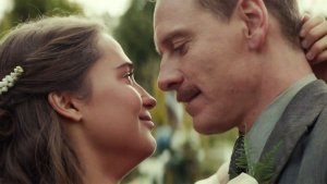 The happy couple, Isabel (Alicia Vikander) and Tom (Michael Fassbender), dancing at their wedding. This photo may be genuine show of affection from the two actors since they are a couple in real life as a result of this film.