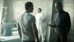 Rikkin (Jeremy Irons, left) telling Cal (Michael Fassbender) about the purpose of his institution.